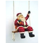 Santa on Swing Figurine